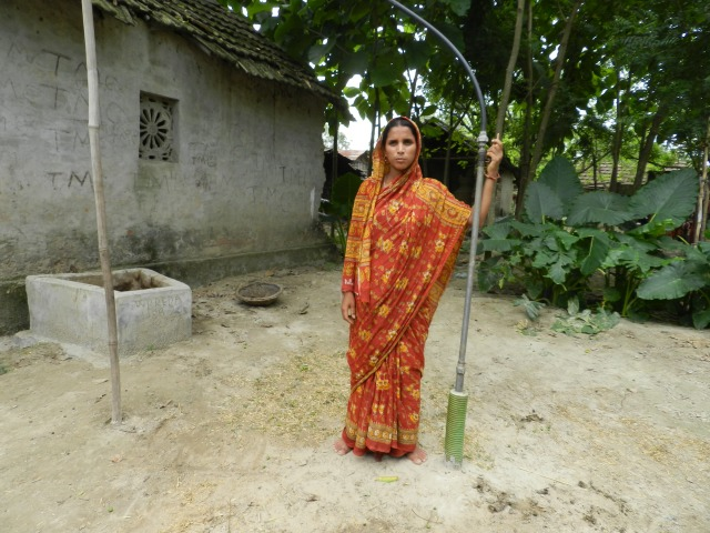 "Ruksanna with her biogas installation works. ""The best thing about having biogas is that I can cook something for my children whenever they want, without having to light a chullah,"" she says."